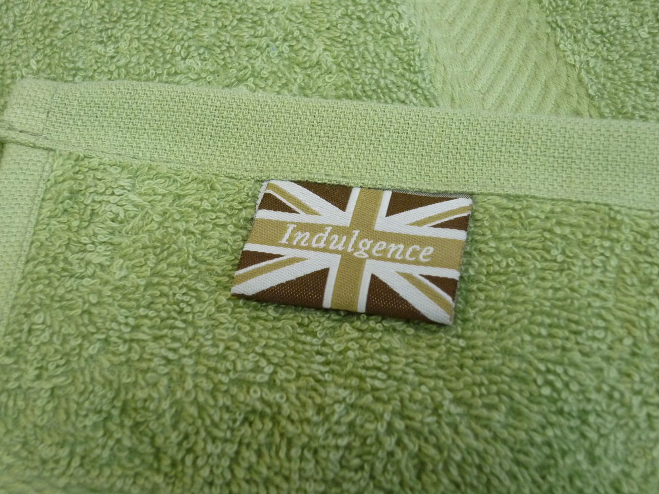 incredibly cheap indulgence 450gsm bath towel in olive green